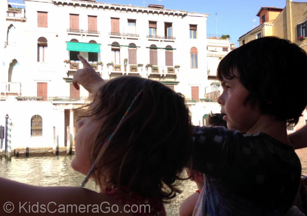 Kids discovering Venice on a water taxi